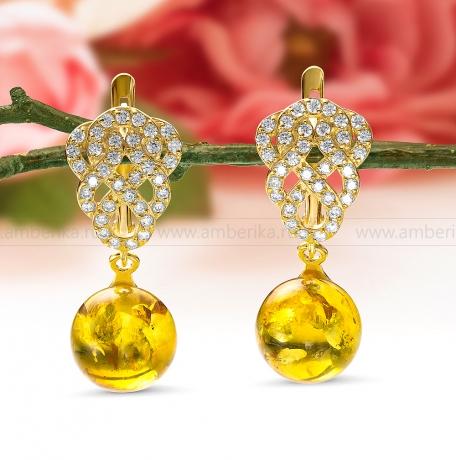 Серьги из серебра, украшенные золотистым природным янтарем