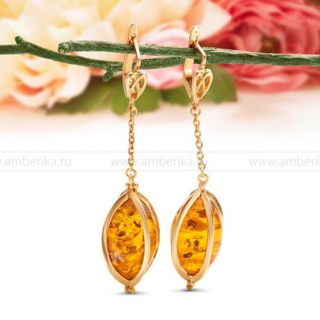 Серьги из серебра с золотым покрытием, украшенные янтарем