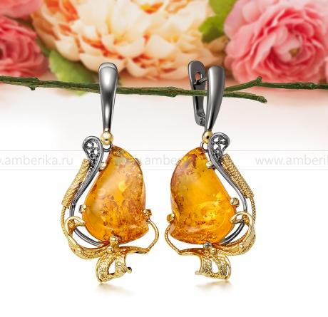 Серьги из серебра, украшенные золотистым балтийским янтарем